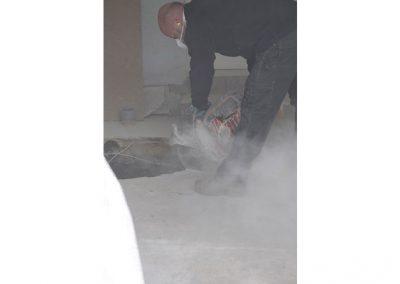 disquage du béton pour la tranchée de raccordement tout à l'égout