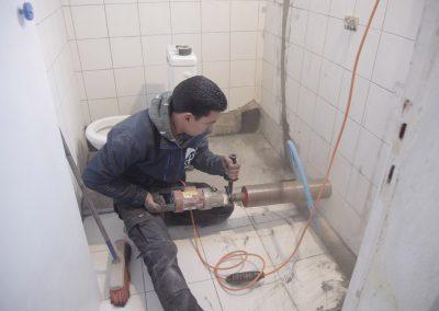 Percement d'un mur pour canalisation wc